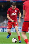 Adelaide United midfielder Ryan Strain (4) warms up at the Hyundai A-League Round 7 soccer match between Melbourne Victory v Adelaide United at Marvel Stadium in Melbourne, Australia.