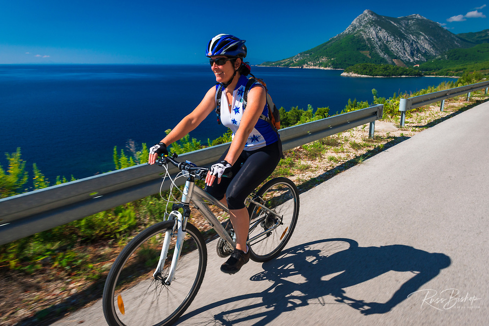 Cycling above the Adriatic Sea nearTrstenik, Peljesac Peninsula, Dalmatia, Croatia
