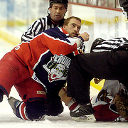 Syracuse, NY / 2004 - Following a fight with Hamilton Bulldog center Steve Ott, Syracuse Crunch defenseman Prestin Ryan gestures to the referee that he was hooked during a game at War Memorial arena. Photo by Mike Roy / For The Syracuse Post-Standard