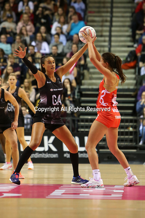 February 2nd 2017, Echo Arena, Liverpool, England; England versus New Zealand Ladies netball, part of the Vitality Netball International Series - Netball Quad Series; Maria Tutaia of New Zealand Silver Ferns attempts to block a pass by Beth Cobden of England Roses