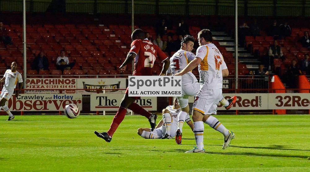 Emile Sinclair slotting in the opening goal. (c) Michael Hulf | SportPix.org.uk