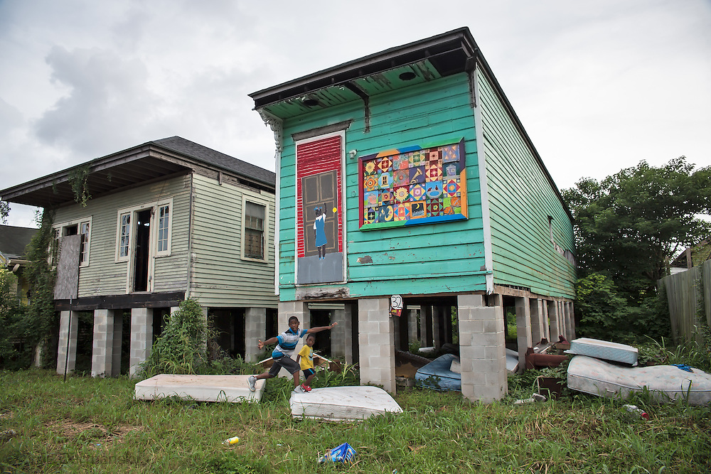 June 13, 2015, New Orleans, LA, Ryanand Brian Ervin play at abandoned homes left in ruin since Hurricane Katrina.