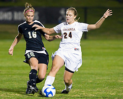 Virginia Cavaliers defender Colleen Flanagan (24) battles with Army midfielder Kelley Robbins  (16).  The #16 ranked Virginia Cavaliers defeated the Army Black Knights 2-0 in the first round of NCAA Division 1 Women's Soccer Tournament at Klockner Stadium on the Grounds of the University of Virginia in Charlottesville, VA on November 14, 2008.