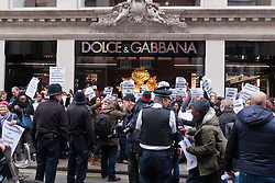 "Mayfair, London, March 19th 2015. Police are called as gay rights campaigners from the Out and Proud Diamond Group, made up of exiled Ugandan and other African gays and their supporters,   demonstrate outside the D&G store in London's Bond Street, following Remarks made by the brand's owners about IVF babies being ""synthetic"". PICTURED: Police are brought in to help control the small but enthusiastic crowd"