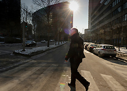 Manfred Bergmann, the European Commission's Directorate General for Taxation and Customs Union, walks from his office to the Berlaymont building, headquarters of the European Commission, for a meeting, on Monday, Feb. 6, 2012, in Brussels. (Photo © Jock Fistick)