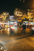 Motorcycles whiz by during rush hour. Hoan Kiem, Hanoi, Vietnam