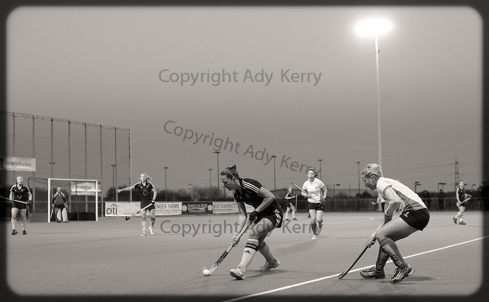 Beeston's Emily Watton is challenged by Canterbury's Nikki Lloyd during their Investec Women's Hockey League Premier Division game at Canterbury HC, 22nd February 2014.