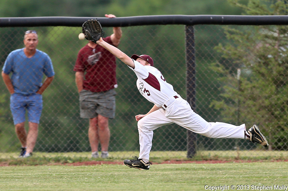 Mount Vernon left fielder Luke Hansen (3) comes up just short on a diving attempt during the 2A District Finals game at West Branch High School in West Branch on Saturday, July 20, 2013.