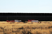Signs placed by the American Border Patrol commenting about the wall marking the U.S./Mexico border remain along the metal wall as seen near the property of Glenn Spencer of the American Border Patrol, Hereford, Arizona, USA.  Spencer monitors smuggling activity along the U.S./Mexico border.