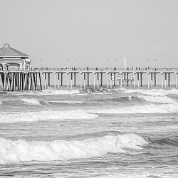 Huntington Beach Pier oanorama photo in black and white. The Panoramic photo ratio is 1:3. Huntington Beach Pier is a registered historic place located in Orange County Southern California. Huntington Beach is also known as Surf City USA. Image Copyright © Paul Velgos with All Rights Reserved.