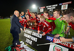 BALLYMENA, NORTHERN IRELAND - Thursday, November 20, 2014: Wales' captain Tyler Roberts lifts the Victory Shield trophy as the players celebrate after beating Northern Ireland 2-0 during the Under-16's Victory Shield International match at the Ballymena Showgrounds. (Pic by David Rawcliffe/Propaganda)