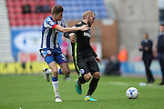 Brighton & Hove Albion midfielder Jiri Skalak (8) and Wigan Athletic defender Reece Burke (32) during the EFL Sky Bet Championship match between Wigan Athletic and Brighton and Hove Albion at the DW Stadium, Wigan, England on 22 October 2016.