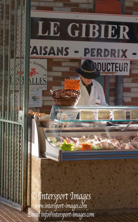 Rennes, FRANCE,  Fresh Produce on display,  Covered meat, game and poultry stalls, at the Saturday Morning Market,  Brittany.  Saturday  26/09/2009   [Mandatory Credit Peter Spurrier Intersport Images]. Street Photo.