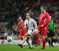 LIVERPOOL, ENGLAND - SUNDAY MARCH 27th 2005: Liverpool Legends' Jan Mølby and Celebrity XI's Marcus Patrick during the Tsunami Soccer Aid match at Anfield. (Pic by David Rawcliffe/Propaganda)