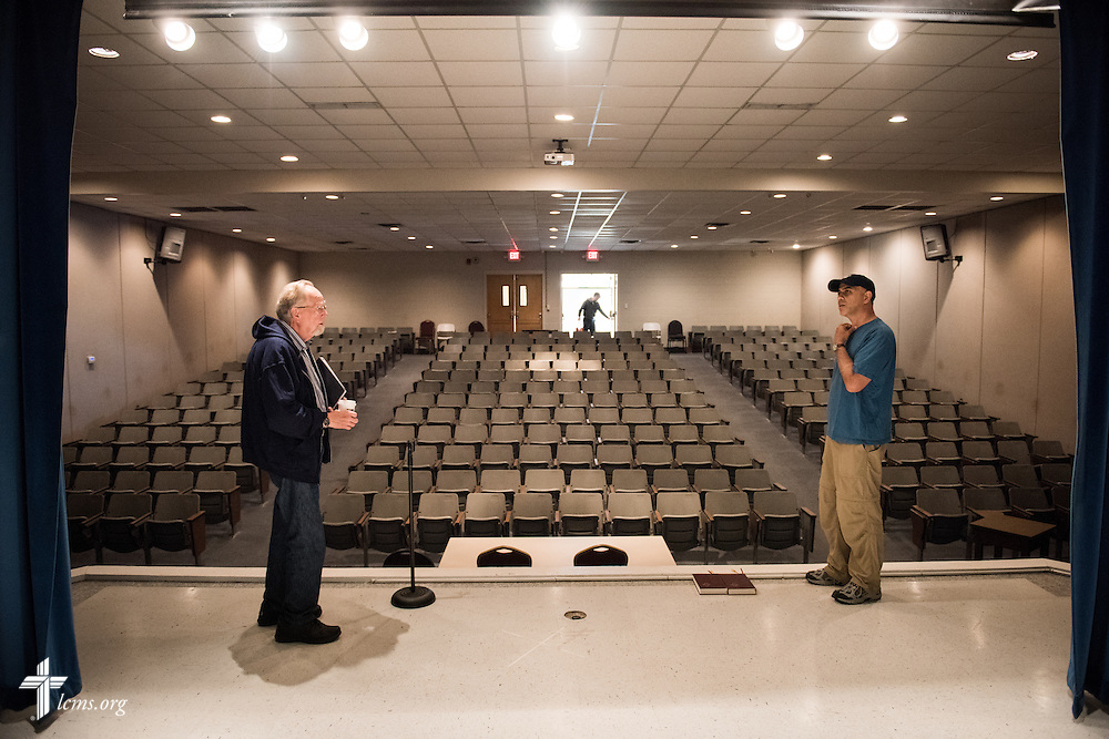 Director Dr. Ardon Albrecht (left) and Ben DeSousa, director of photography, plan out a scene in the auditorium of Concordia College Alabama before the day's filming of 'The First Rosa' documentary begins on Thursday, September 25, 2014, in Selma, Ala. LCMS Communications/Erik M. Lunsford