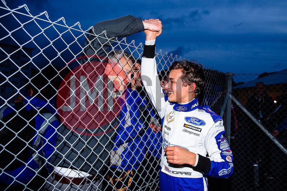 Lando Norris celebrates with Mark Berryman of ADD Motorsports after winning the Championship Title with a race to spare | #31 Carlin | MSA Formula Championship | Race 2 - Mandatory byline: Rogan Thomson/JMP - 07966 386802 - 10/10/2015 - MOTORSPORT - Brands Hatch GP Circuit - Fawkham, England - BTCC Meeting Day 1.