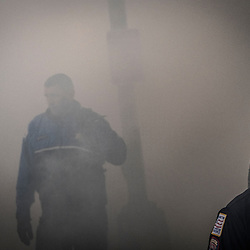 Police and security walk through the smoke of a burning limousine following the swearing in of the 45 President of the United States, Donal J. Trump on K Street in Washington, D.C., Friday Jan. 20, 2017. ( William B. Plowman / REDUX Photo )