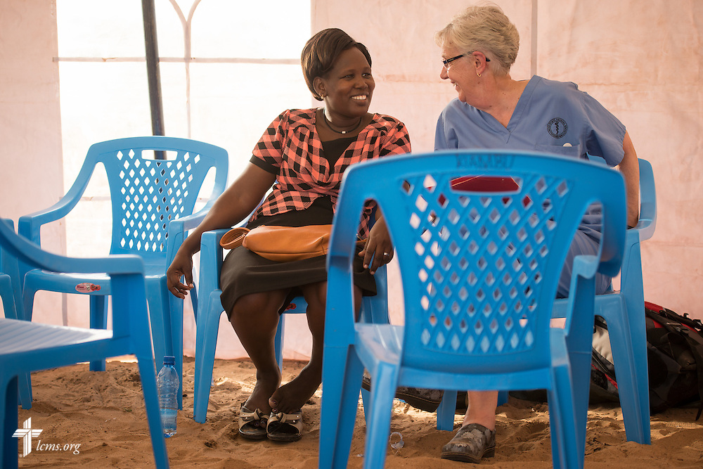 Helene Kuempel, a retired nurse and a member of Trinity Lutheran Church, Guttenberg, Iowa, shares a laugh with her Kenyan colleague during the LCMS Mercy Medical Team on Monday, June 20, 2016, in Nataparkakono, a village in Turkana, Kenya.  LCMS Communications/Erik M. Lunsford