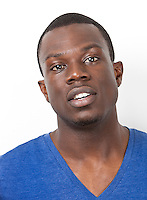 Portrait of young African American man against white background