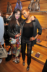 Left to right, NAMALEE BOLLE and TOLULA ADEYEMI at a party in aid of the charity Best Buddies held at the Hogan store, 10 Sloane Street, London SW10 on 13th May 2009.