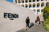 """ROME, ITALY - 15 OCTOBER 2018: FENDI employees arrive at the Fendi Headquarters at the Palazzo della Civiltà Italiana, also called the """"Colosseo Quadrato"""" (Square Colosseum), in Rome, Italy, on October 15th 2018.<br /> <br /> The LVMH Journées Particulières is is a series of exhibitions that show the creations and history of the LVMH fashion houses. The driving theme behind the Journées Particulières is to allow the general public to discover the inner workings of the Houses which are part of the LVMH heritage.The LVMH Journées Particulières exhibition by fashion house FENDI takes place at their headquarters at the Palazzo della Civiltà Italiana, also called the """"Colosseo Quadrato"""" (Square Colosseum),  an outstanding jewel of the 20th century Roman architecture."""