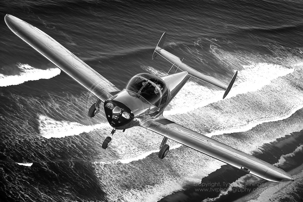 Flown by Erick Teeters, a highly polished 1966 Alon A2 Aircoupe, N6511Q, skirts the Monterey Bay coastline.