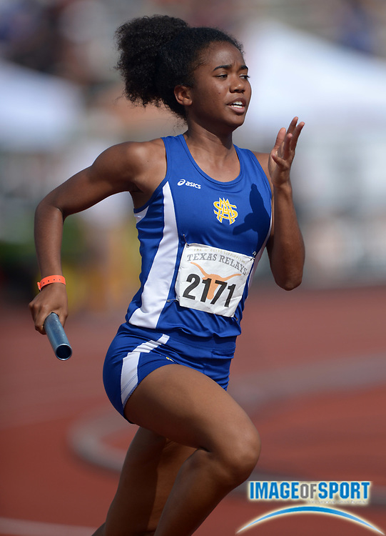 Mar 28, 2014; Austin, TX, USA; Aliyah Hale runs the second leg on the St. Mary's Academy girls 4 x 400m relay that ran 3:53.35 for the top Division I qualifying time in the 87th Clyde Littlefield Texas Relays at Mike A. Myers Stadium.