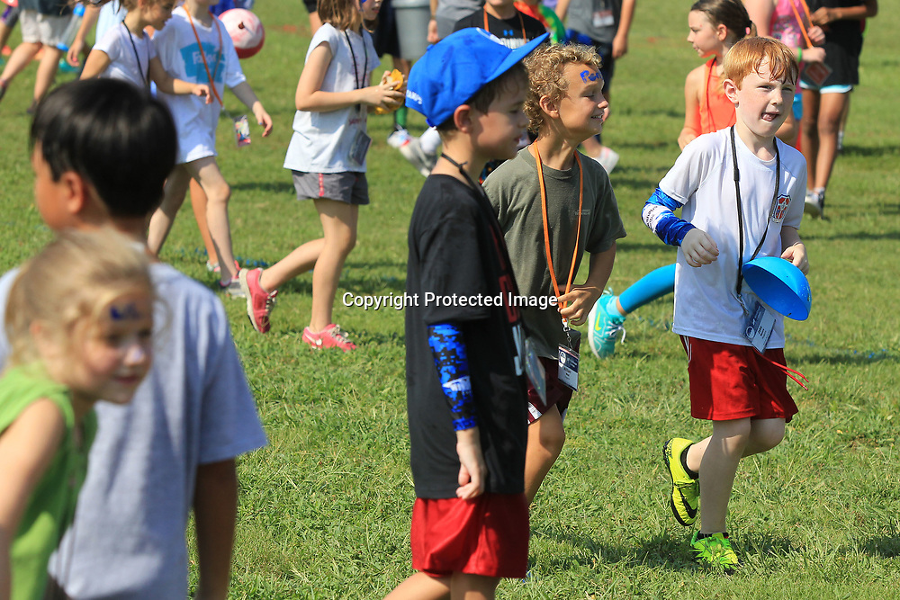 """Jake Moore, 8, of Tupelo, races in with a cone in the clean up challenge after his group finishes """"Connectreation"""" time at WinShape Camp Wednesday morning at Harrisburg Baptist Church in Tupelo."""