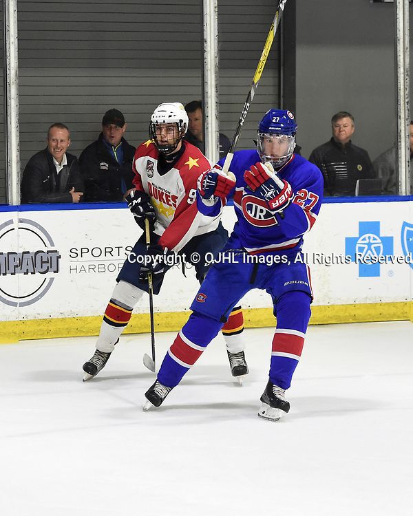 BUFFALO, NY - SEP 20,  2017: Ontario Junior Hockey League Governors Showcase game between the Toronto Jr. Canadiens and Wellington Dukes, David Sherman #27 of the Toronto Jr. Canadiens and Nick Durajlija #9 of the Wellington Dukes pursue the play during the third period.<br /> (Photo by Andy Corneau / OJHL Images)