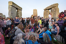 © Licensed to London News Pictures.21/06/2017. Stonehenge, Amesbury, Wiltshire, UK. Revellers at the Summer Solstice celebrations at Stonehenge on the longest day of the year. Photo credit : Simon Chapman/LNP