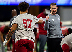 The Oklahoma Sooners practice at Mercedes Benz Stadium on Dec. 26, 2019, in Atlanta. Oklahoma will face LSU in the 2019 College Football Playoff Semifinal at the Chick-fil-A Peach Bowl. (Jason Parkhurst via Abell Images for the Chick-fil-A Peach Bowl)