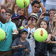 Fans wait for autographs from Serena Williams, USA, after her victory over Madison Keys, USA, during the US Open Tennis Tournament, Flushing, New York, USA. 6th September 2015. Photo Tim Clayton