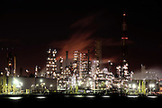 Nippon Oil Corp.'s Negishi refinery is lit up at night at a port in Yokohama, Japan on 12 January 2009.