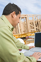Architect using laptop on construction site