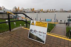© Licensed to London News Pictures. 10/02/2020. London, UK. Flooding is seen at the Thames Barrier in London which is seen closed this afternoon at high tide to protect the capital from flooding during Storm Ciara. The Thames Barrier prevents the floodplain of most of Greater London from being flooded by exceptionally high tides and storm surges.  Photo credit: Vickie Flores/LNP
