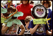 Kids with monkey and snake masks march in Earth Day parade at Forest Park in St. Louis. Missouri