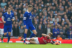 08.03.2014, Emirates Stadium, London, ENG, FA Cup, FC Arsenal vs FC Everton, Viertel Finale, im Bild Everton's John Stones is tackled by Arsenal's Mathieu Flamini // during the English FA Cup quater final match between Arsenal FC and Everton FC at the Emirates Stadium in London, Great Britain on 2014/03/08. EXPA Pictures © 2014, PhotoCredit: EXPA/ Propagandaphoto/ David Rawcliffe<br /> <br /> *****ATTENTION - OUT of ENG, GBR*****