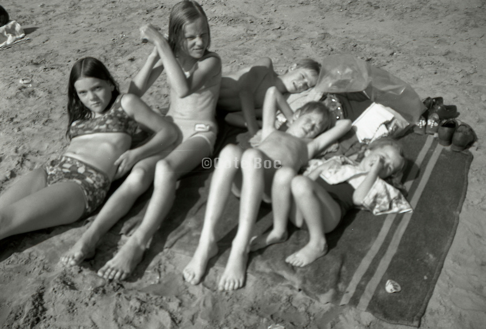 All together resting and sunning after a swim Holland 1960s