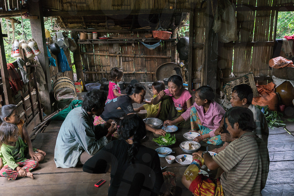 Aug. 17, 2016 - Kbal Romeas (Cambodia). Je Srey Neang (wearing a pink t-shirt) has lunch with her extended family in her small house in Kbal Romeas. In the last couple of years she and her family fought hard the relocation's plan. She was born in the village and she's worried of loosing their identity as indigenous once they will leave the ancestral land and forest. The family was threatened several times by the company but she always refused their offers.  © Thomas Cristofoletti / Ruom