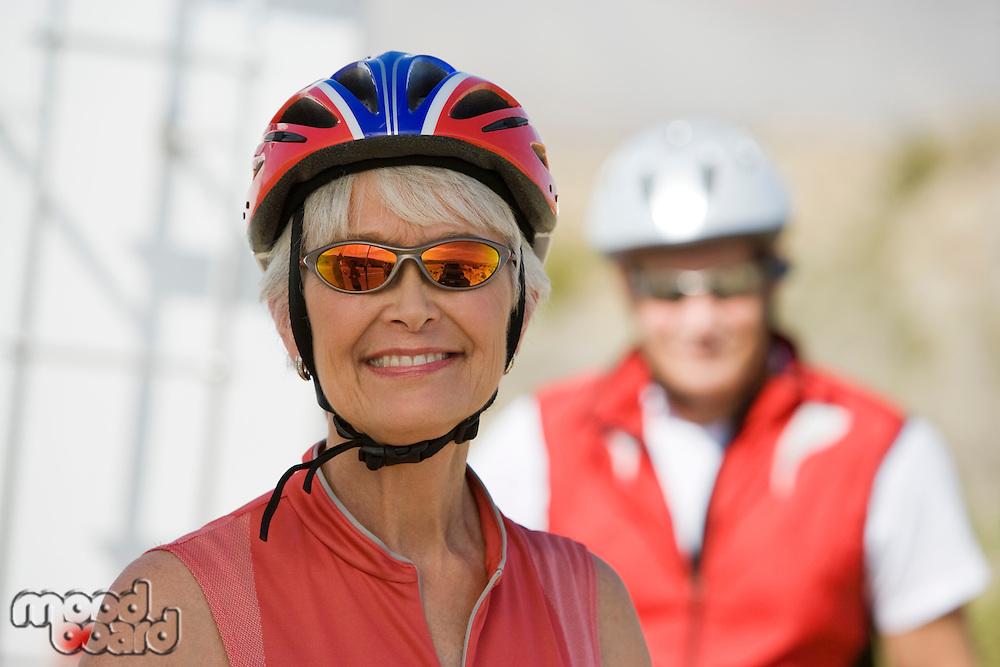 Senior woman wearing cycling helmet