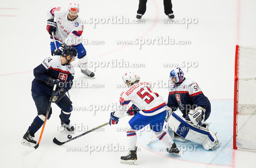 Daniel Sorvik of Norway and Mats Rosseli Olsen of Norway vs Andrej Meszaros of Slovakia and Jan Laco of Slovakia during Ice Hockey match between Slovakia and Norway at Day 6 in Group B of 2015 IIHF World Championship, on May 6, 2015 in CEZ Arena, Ostrava, Czech Republic. Photo by Vid Ponikvar / Sportida