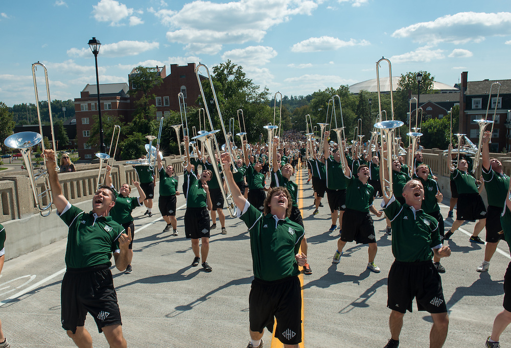 Members of the Marching 110 lead nearly 4,000 students to the the Student Involvement Fair following the First Year Student Convocation. Photo by Ben Siegel