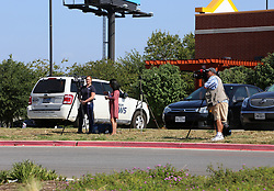 July 23, 2017 - San Antonio, Texas, U.S. - Local journalists work near a Walmart parking area after it was cordoned off by local police in San Antonio, Texas, the United States, on July 23, 2017. Eight people were found dead in a trailer carrying illegal immigrants at the Walmart parking area in southern Texas City of San Antonio early Sunday morning, authorities said. (Credit Image: © Yan Bo/Xinhua via ZUMA Wire)