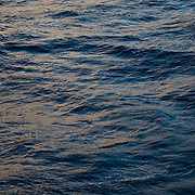 Subtle colors from the dusk sky are reflected on the surface of the deep blue water of Drake Passage. In this part of Drake Passage the water is approximately 4000 metres (13,000 feet) deep.