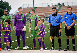24 June 2015. New Orleans, Louisiana.<br /> National Premier Soccer League. NPSL. <br /> Jesters 0 - Atlanta Silverbacks 1.<br /> The New Orleans Jesters and junior academy players before the game at home in the Pan American Stadium. <br /> Photo©; Charlie Varley/varleypix.com