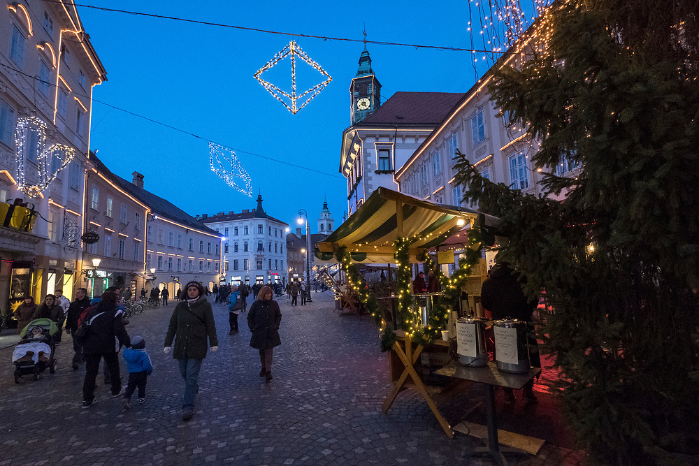 LJUBLJANA, SLOVENIA - DECEMBER 02:  Locals and tourists walk along Mestni Trg. on December 2, 2017 in Ljubljana, Slovenia. The traditional Christmas market and lights will stay until 1st week of January 2018.  (Photo by Marco Secchi/Getty Images)
