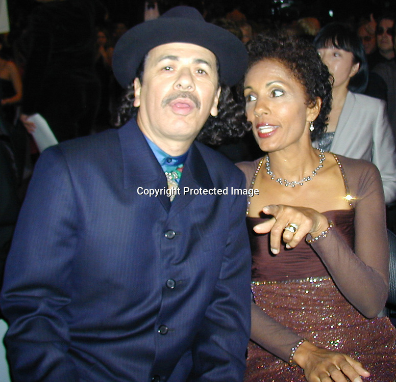Carlos and Brenda Santana<br />*****EXCLUSIVE*****<br />42nd Annual Grammy Awards Backstage <br />Staples Center<br />Los Angeles, CA, USA<br />February 23, 2000<br />Photo By Celebrityvibe.com/Photovibe.com