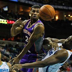 February 2, 2012; New Orleans, LA, USA; Phoenix Suns point guard Ronnie Price (2) passes as New Orleans Hornets center Emeka Okafor (50) defends during the second half of a game at the New Orleans Arena. The Suns defeated the Hornets 120-103.  Mandatory Credit: Derick E. Hingle-US PRESSWIRE