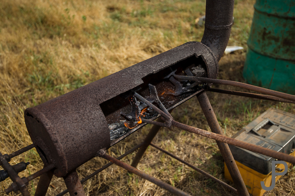 Woodward, OK - Branding irons are heated in the propane oven prior to cattle branding at Howard Ranch.