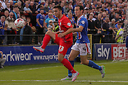 York City forward, on loan from Oldham Athletic, Rhys Turner controls the ball ahead of Carlisle United midfielder Luke Joyce during the Sky Bet League 2 match between York City and Carlisle United at Bootham Crescent, York, England on 19 September 2015. Photo by Simon Davies.